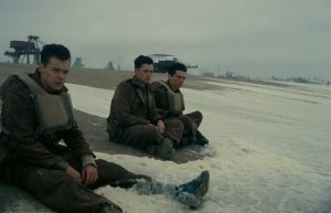 Dunkirk-close-up-soldiers-on-beach