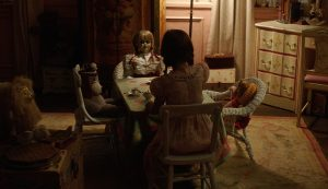 Annabelle-Creation-playing-at-table