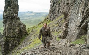 DVD-king-arthur-lengend-hunnam-walking-up-mountain