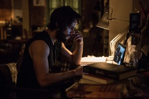 American-Assassin-at-desk